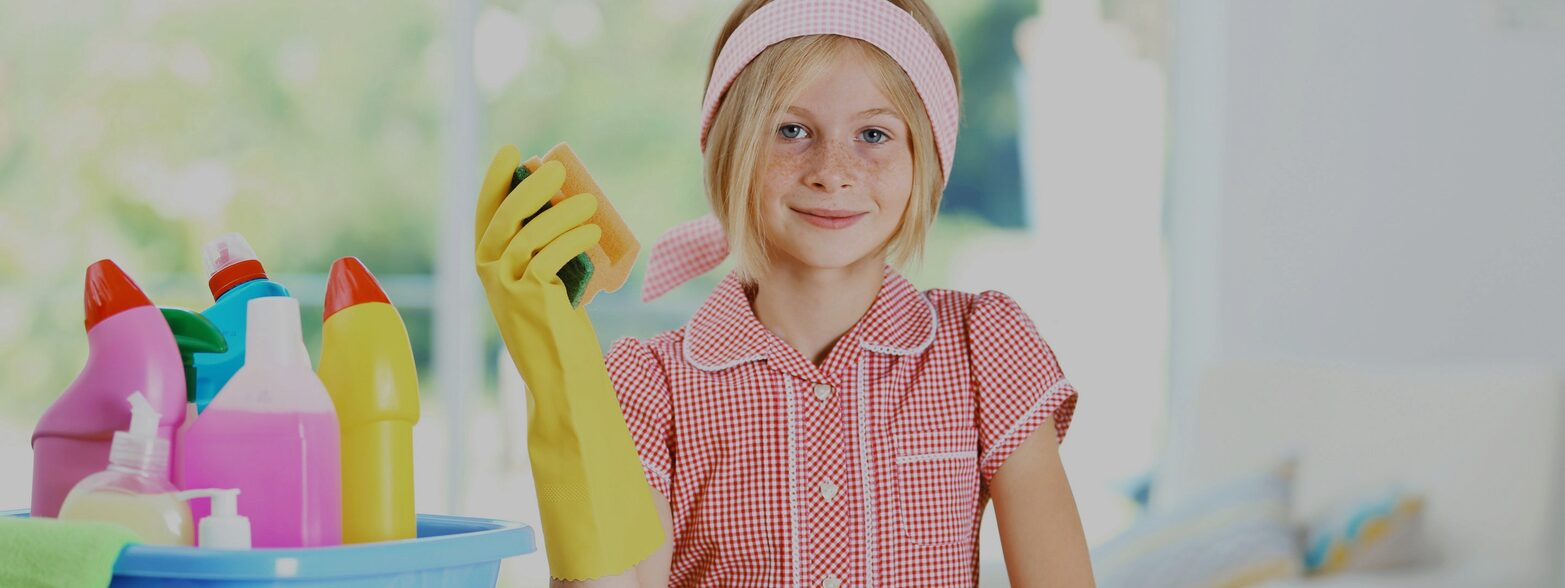 Young girl with cleaning supplies